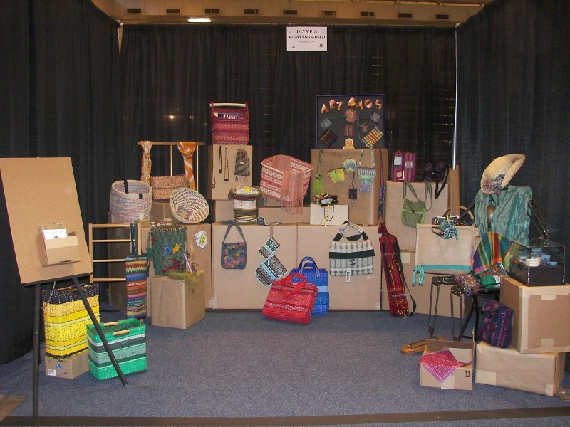 "Olympia Weavers Guild 2013 ANWG booth ""The Baggage We Carry."""